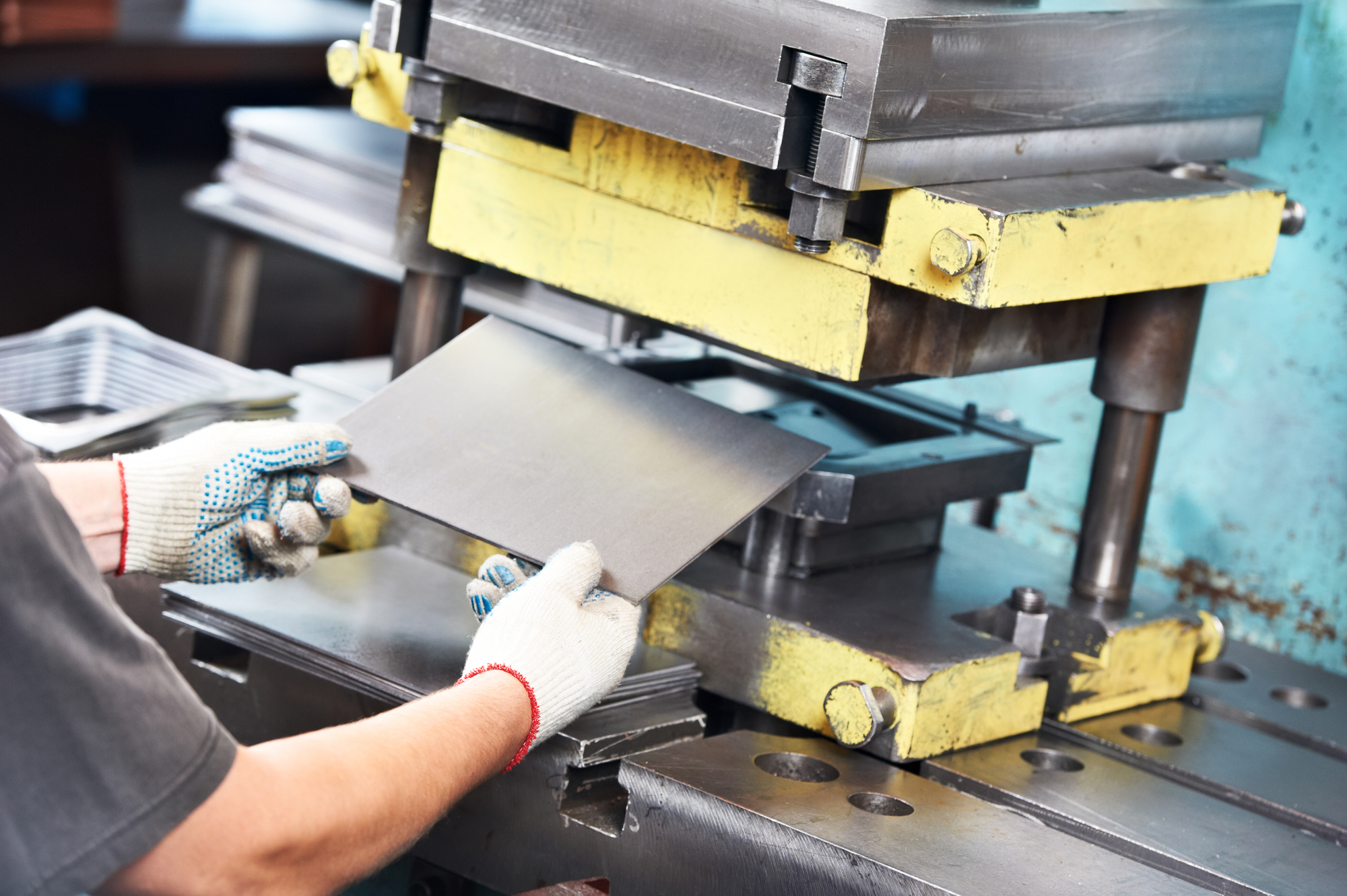 worker operating metal sheet press machine